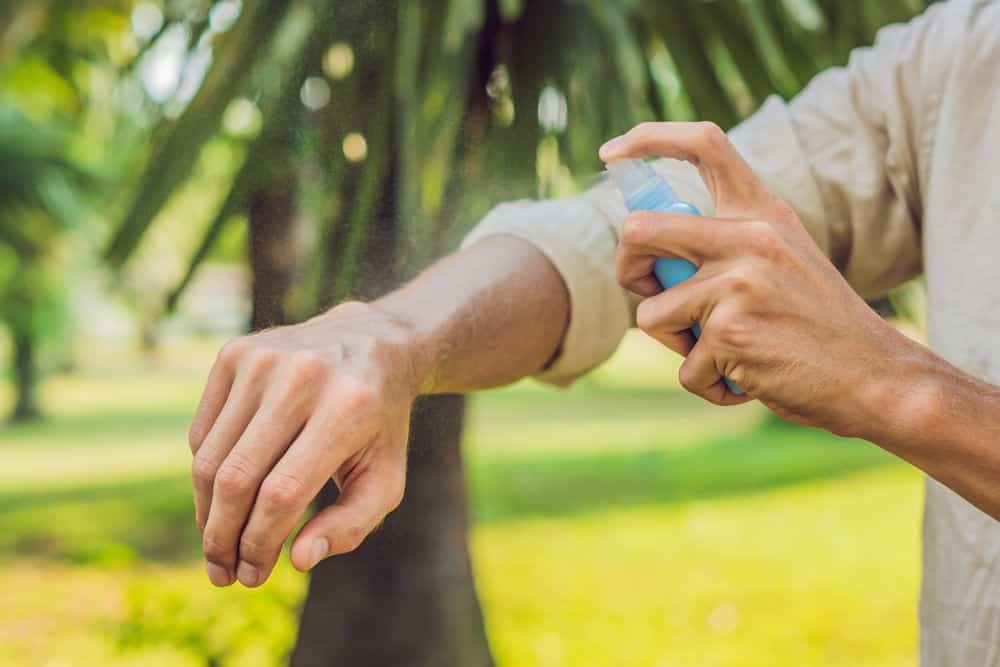 mosquito spray on arm